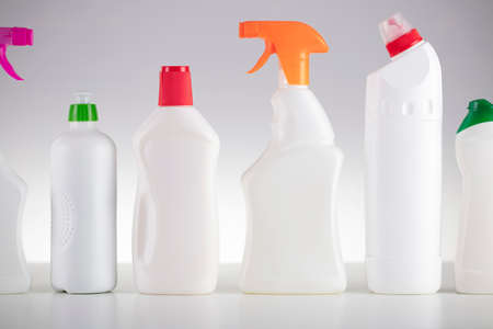 Photo for House and office cleaning theme. Set of white bottles with clining liquids on the white  background. - Royalty Free Image