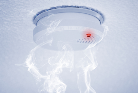 Photo for fire detector with alert and smoke - Royalty Free Image