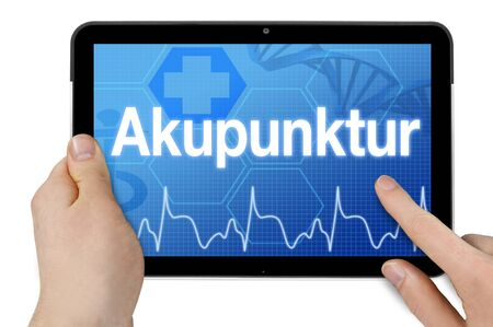 Tablet computer with the german word for acupuncture - acupuncture