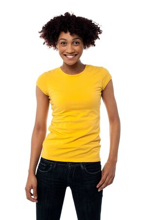 Portrait of young smiling afro american woman in trendy clothing.