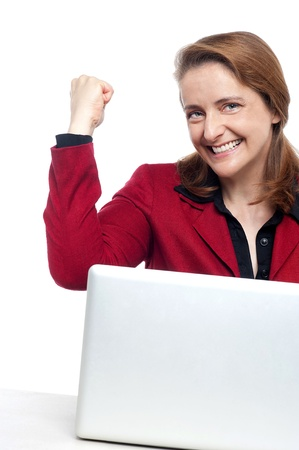 Cropped image of an excited businesswoman celebrating her success.の写真素材