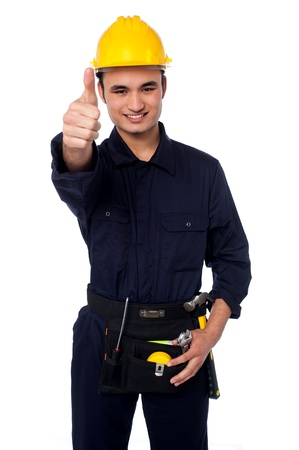 Handsome man in yellow safety helmet and construction worker uniform