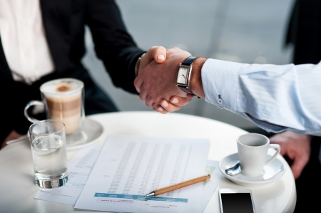 Two business tycoons meet over a coffee and closed long-term deal