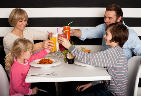 It's celebration time. Family toasting smoothies.