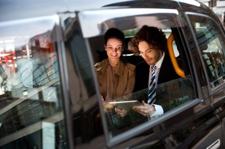 Photo pour Business people traveling around the city - image libre de droit