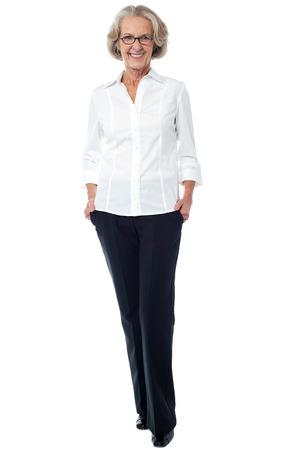 Attractive senior lady in business attire