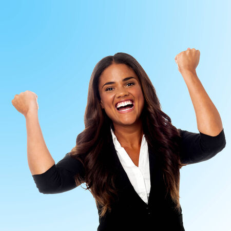 Businesswoman clenching her fists in excitement