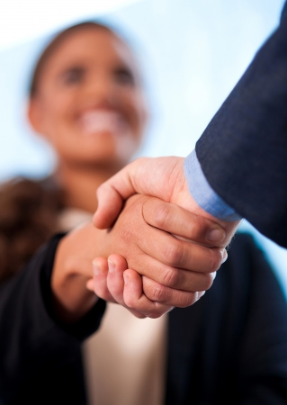 Image of two business people shaking handsの写真素材