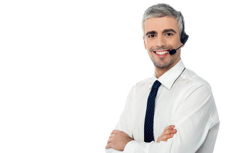 Crossed arms call center operator with headset
