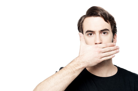 Scared young man with hand cover his mouth