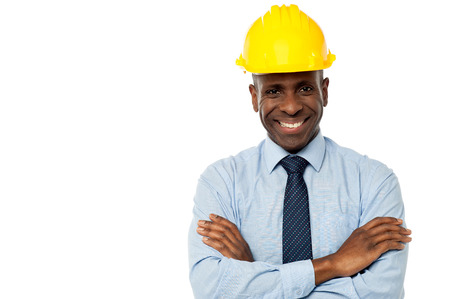 Construction engineer in hard hat with his arms crossed