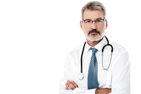 Mature male physician posing with stethoscope over white