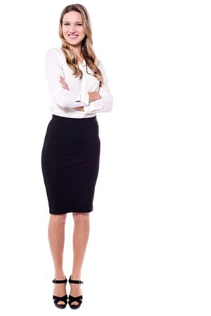 Elegantly dressed business woman posing with crossed arms