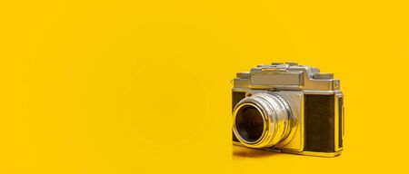 Photo for Close up photo of old vintage camera on yellow background with copy space - Royalty Free Image