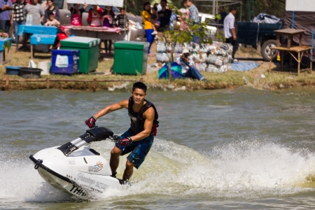 SARABURI THAILAND-JANUARY 20: Veerapong Maneechom in action during show Freestyle the Jet ski  stunt action  on Jan 20, 2013 in SARABURI,Thailand.