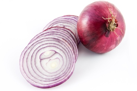 Picture of a red onion sliced up and a whole one