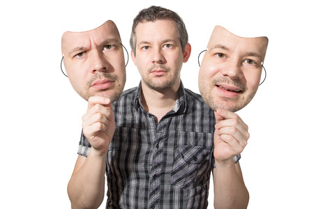 Photo for Picture of a man choosing the right face for the day - Royalty Free Image