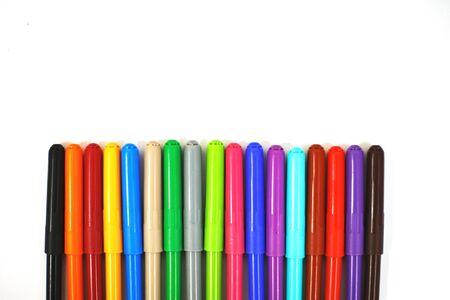Photo pour multi-colored felt-tip pens on a white sheet of paper. felt-tip pens on a white background - image libre de droit