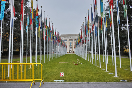 United nations building with flags in Geneva, Switzerland