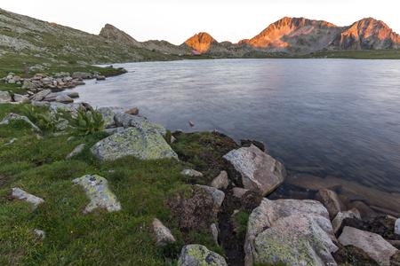 Sunset landscape with Kamenitsa peak and Tevno lake, Pirin Mountain, Bulgaria