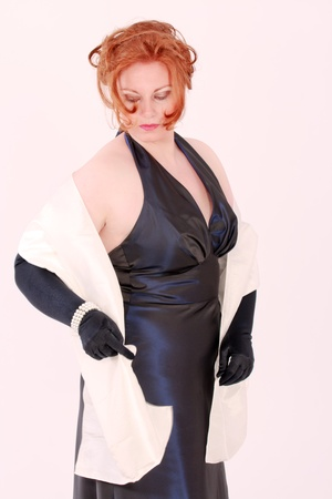 Elegant young redheaded Plus Size Model in black evening dress
