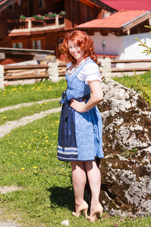 Red-haired beauty in Bavarian Dirndl