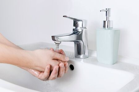 Photo pour Male cleaning hands. Washing hands with soap to protect from coronavirus - image libre de droit