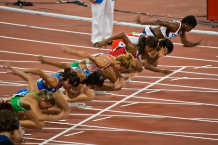 Beijing , China - Aug 18, 2008 OLYMPICS: Women Athletes take off at start of  100 meter race