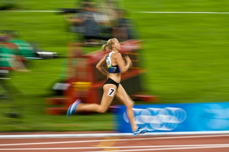Beijing, China - Aug 18, 2008 Olympics: Kaie Kand breaks away from field of runners to win 800 meter womens race