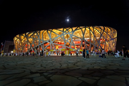 Beijing - Aug 16: Spectators leaving the Birds Nest Stadium at night during the Summer Olympic games August 16, 2008 Beijing, China.