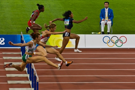 Beijing, China Olympics - Aug 18, 2008: Female Athletes competing in 100 meter sprint for women