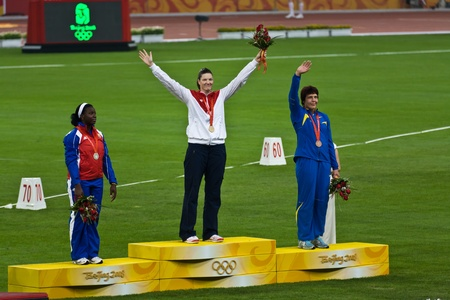 Beijing, China Olympics, Aug 18, 2008: Stephanie Trafton Brown, USA, receives the discus throw gold medal for women