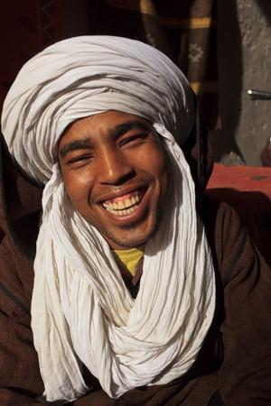 Essaouira, Morocco - Jan 13: Portrait of smiling Berber man with white turban head garb, January 13, 2010 Essaouira, Morocco.