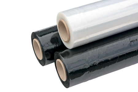 Photo for Three rolls of stretch film packaging black and transparent. Wrapping film. Isolated on white background. - Royalty Free Image