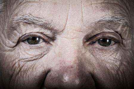 Photo pour Portrait of elderly woman. Closeup view. Toned. - image libre de droit