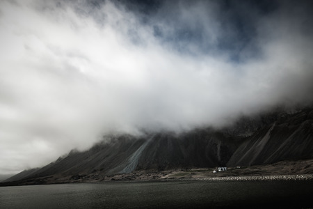 Photo pour Beautiful spring sea landscape with low clouds in Iceland fjord. Toned. - image libre de droit