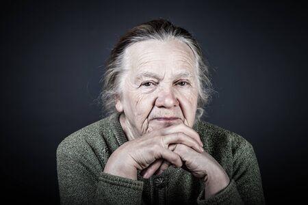 Photo pour Portrait of elderly woman. Thoughtfulness. Toned. - image libre de droit