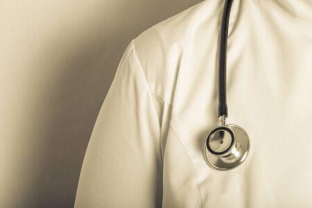 Photo pour Woman doctor in uniform with a phonendoscope. Toned. - image libre de droit