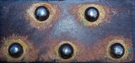 Photo pour Porous sheet of old metal with rivets in detail - image libre de droit