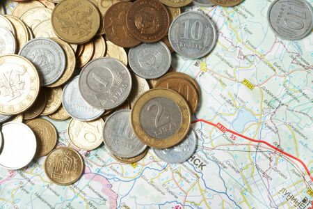 Coins lay on a map