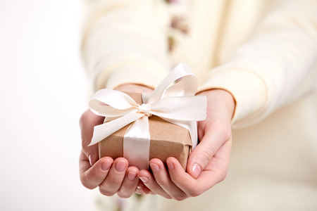 Photo for hands holding craft gift box - Royalty Free Image