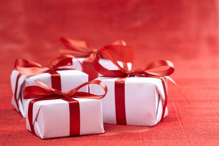Foto de presents with red ribbons for Valentine day - Imagen libre de derechos
