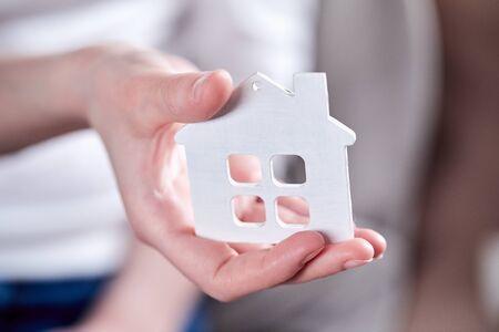 Photo pour Female hands holding model of house - image libre de droit