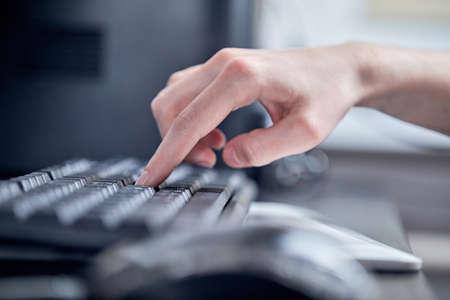 Foto de Female hands or woman office worker typing on the keyboard - Imagen libre de derechos