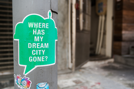 Sticker on a Hong Kong lampst asking Where has my dream city gone?