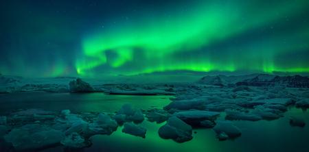 Photo for Aurora borealis above Jokulsarlon glacier lagoon, Iceland - Royalty Free Image