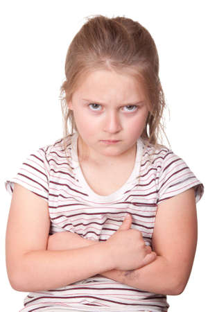 A photograph of a young girl with her arms crossed and very mad.