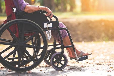 Photo pour Old people on wheel chair - image libre de droit
