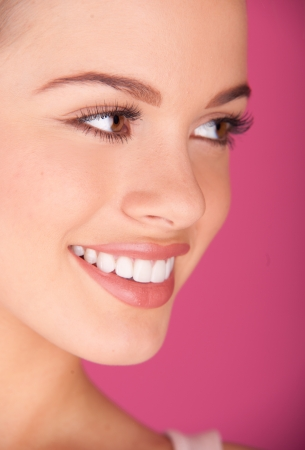 Beautiful young woman  perfect teeth smiling