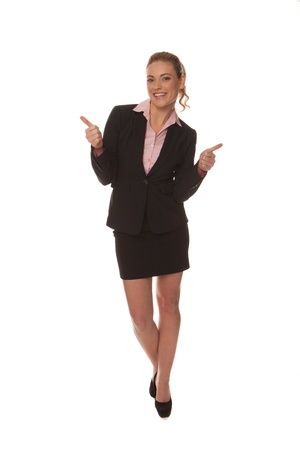 Enthusiastic happy businesswoman in a stylish miniskirt gesturing with her hands as she walks along isolated on white